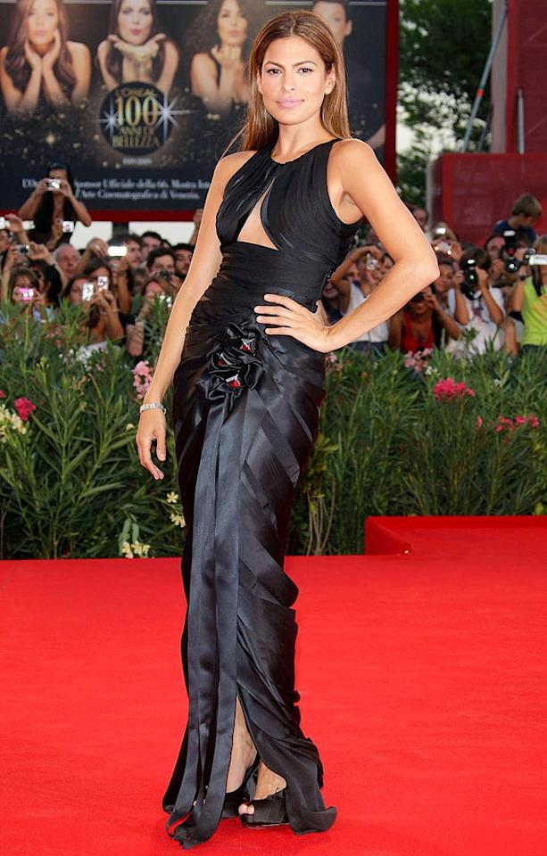 """Honestly? Does it get any better than this? Eva Mendes continued her red carpet reign at the 66th Annual Venice Film Festival in an awesome Armani gown, which featured a keyhole bodice and jeweled detailing on the hip. Venturelli/<a href=""""http://www.wireimage.com"""" target=""""new"""">WireImage.com</a> - September 4, 2009"""