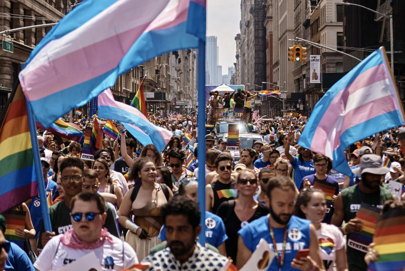 In this June 24, 2018 file photo, revelers take to the streets during the New York City Pride Parade in New York. New York City will host two parades on Sunday, June 30, 2019, in celebration of the 50th anniversary of the Stonewall uprising. The smaller of the two, Queer Liberation March, starts at 9:30 a.m. and the larger Pride march steps off at noon. (AP Photo/Andres Kudacki, File)