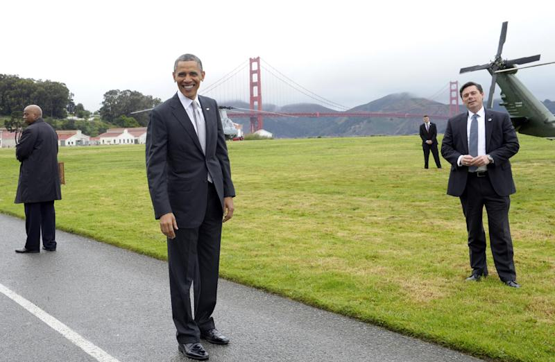 President Barack Obama stands with a view of the Golden Gate bridge before getting on Marine One in San Francisco, Thursday, April 4, 2013. Obama will be attending Democratic fundraisers while in California. (AP Photo/Susan Walsh)