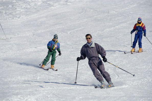 <p>It's no secret that the royals love this Alpine resort village that's huge with celebrities, and they've gone there multiple times. Here, a young Prince William and Prince Harry join their father for a ski trip. </p>