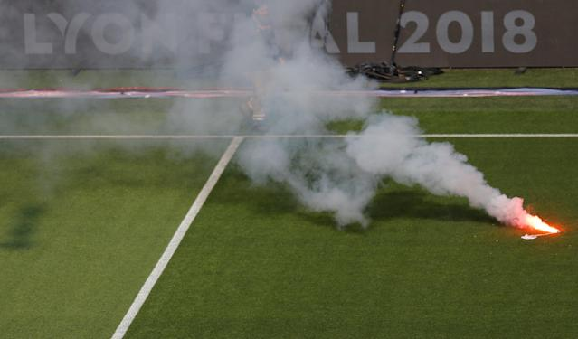 Soccer Football - Europa League Final - Olympique de Marseille vs Atletico Madrid - Groupama Stadium, Lyon, France - May 16, 2018 A flare lands on the pitch after it was thrown from outside the stadium before the match REUTERS/Vincent Kessler