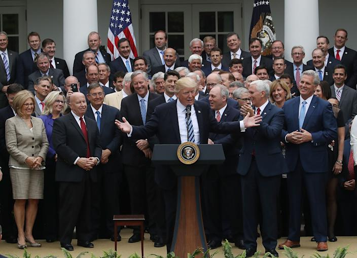 President Trump at podium flanked by House Republicans