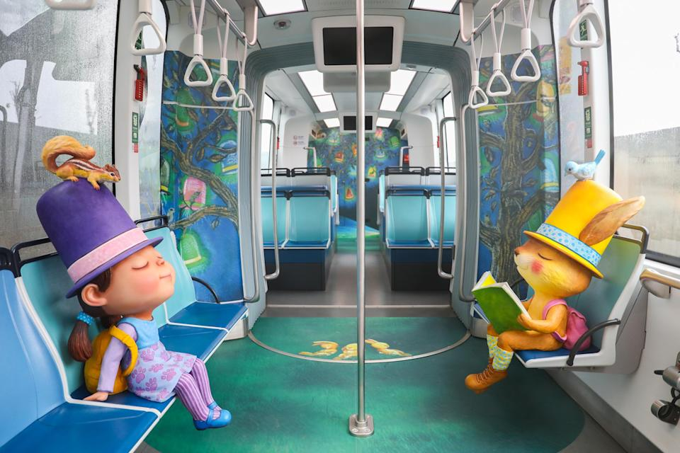 <p>The themed trains are decorated with Liao's paintings as well as dolls inspired by the characters in Liao's illustrative books. (Courtesy of New Taipei Metro Corporation)</p>