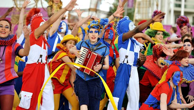 LONDON, UNITED KINGDOM - JULY 20: The sight that greets arriving Athletes and Officials from all over the World at their Olympic Athletes Village, where members of the National Youth Theatre of Britain welcome them with song and dance routines, on July 20, 2012 in London, England. The opening ceremony of the games will take place in seven days. (Photo by John Stillwell - WPA Pool /Getty Images)