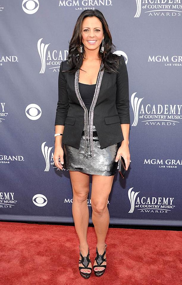"Sara Evans  Grade: B   Sara Evans showed off her gams in a sparkly-yet-rather-casual BCBG Max Azria dress, blazer, and strappy platform sandals. Rick Diamond/ACMA2011/<a href=""http://www.gettyimages.com/"" target=""new"">GettyImages.com</a> - April 3, 2011"