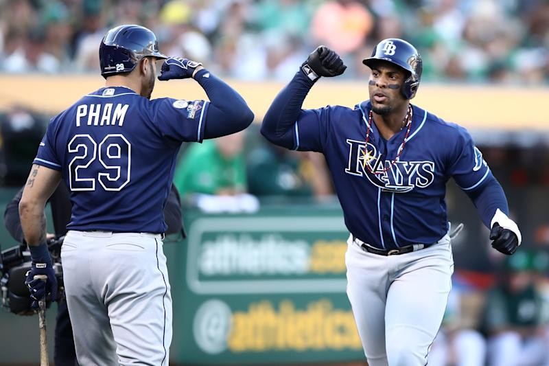 OAKLAND, CALIFORNIA - OCTOBER 02: Yandy Diaz #2 of the Tampa Bay Rays celebrates with Tommy Pham #29 after his solo home run off Sean Manaea #55 of the Oakland Athletics in the first inning of the American League Wild Card Game at RingCentral Coliseum on October 02, 2019 in Oakland, California. (Photo by Ezra Shaw/Getty Images)