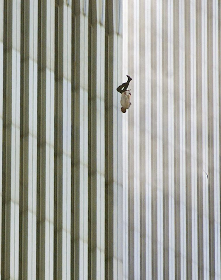 "In a scene repeated with terrifying frequency as flames engulfed the top of the towers, a man falls (or leaps, as was evidently the case with many victims) to his death from the World Trade Center. On the morning of September 11 photographer Richard Drew, in the midst of another assignment, got the call to drop everything and head to the World Trade Center. As soon as he arrived downtown he began shooting; later in the day, as as he processed what he had shot, he was especially struck by this photo -- and with reason. One of the most recognizable pictures made on 9/11, the image from a purely photographic perspective is breathtaking: the miniscule human form caught against the massive, abstract background of the towers is so obviously helpless, and doomed, that we're tempted to reach out our hands to try and cradle the tiny anonymous figure. And while Drew himself refuses to conjecture about the man's identity (""I prefer to think of him as a sort of Unknown Soldier,"" he told LIFE.com), it's impossible not to put ourselves in the falling man's place -- with all the dread and empathy that that sort of transference commands. <br><br>(Photo: AP Photo/Richard Drew)<a target=""_blank"" href=""http://www.life.com/gallery/59971/911-the-25-most-powerful-photos#index/0""><br></a>"