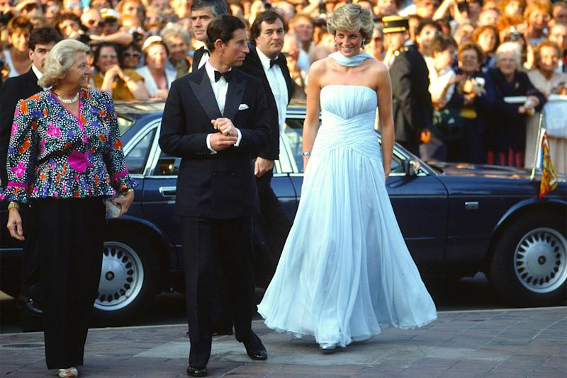 The couple arrives at the Cannes Film Festival, she in blue silk chiffon gown by Catherine Walker.
