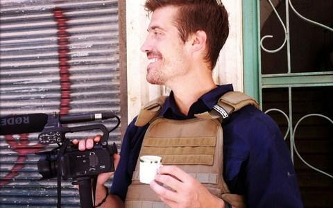 Journalist James Foley - here seen in Aleppo, Syria, in July 2012 - was beheaded by Isil - Credit: AP Photo/freejamesfoley.org, Nicole Tung