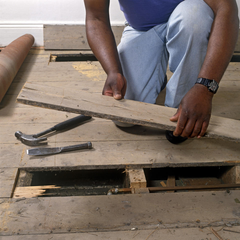 Replacing a damaged floor board. (Photo by DIY Photolibrary/Construction Photography/Avalon/Getty Images)