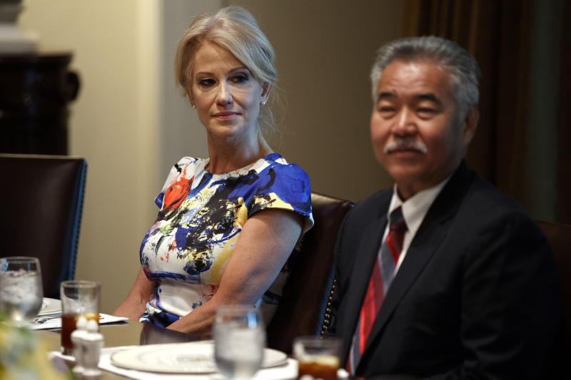 "White House counselor Kellyanne Conway, left, and Hawaii Gov. David Ige listen as President Donald Trump speaks during a meeting with governors on ""workforce freedom and mobility"" in the Cabinet Room of the White House, Thursday, June 13, 2019, in Washington. (AP Photo/Evan Vucci)"