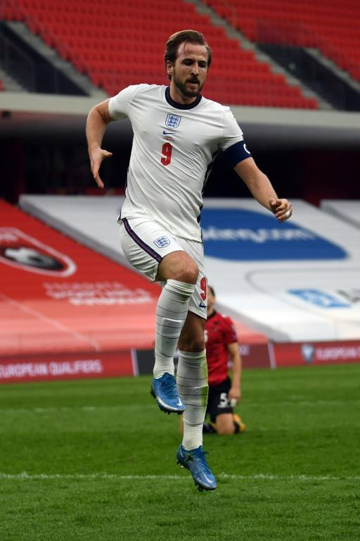 Jumping for joy: Harry Kane celebrated after heading England in front in Albania