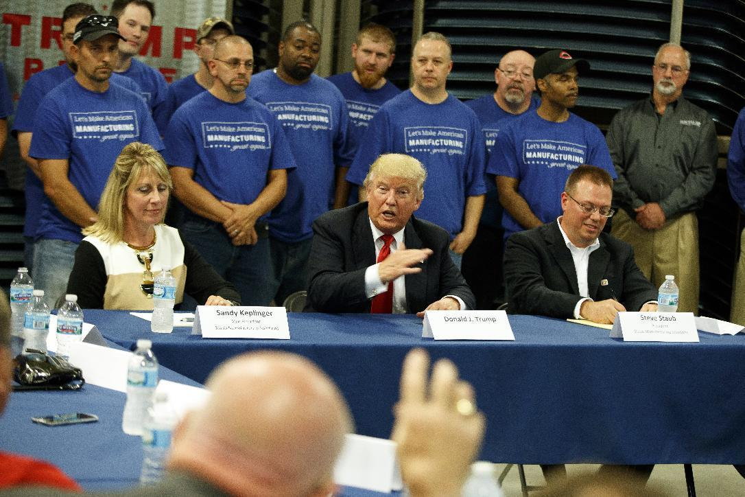 Republican presidential candidate Donald Trump speaks during a roundtable on manufacturing following a tour of Staub Manufacturing, Wednesday, Sept. 21, 2016, in Dayton, Ohio. (AP Photo/ Evan Vucci)
