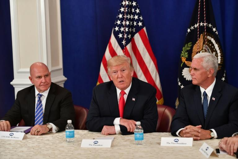 US National Security Advisor H.R. McMaster, President Donald Trump and Vice President Mike Pence (L to R) were among those attending Friday's talks at Camp David