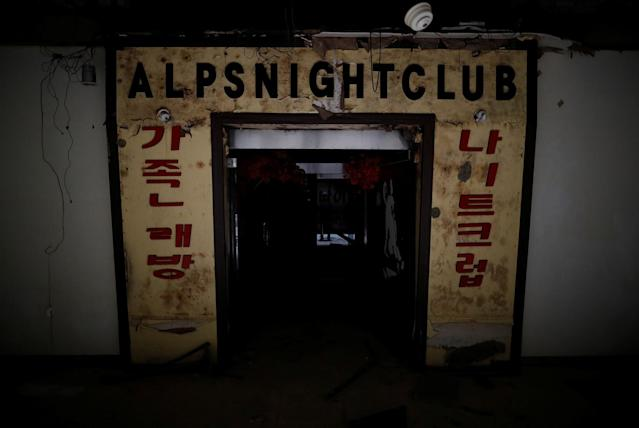<p>An entrance of the Alps nightclub is seen at the abandoned Alps Ski Resort located near the demilitarized zone separating the two Koreas in Goseong, South Korea, Jan. 17, 2018. (Photo: Kim Hong-Ji/Reuters) </p>
