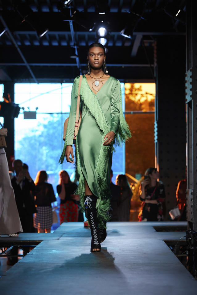 <p><i>A model in a dress with green fringe accents. (Photo: ImaxTree) </i></p>