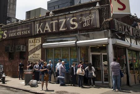 People stand in line at Katz's Delicatessen, the famous deli founded in 1888, in New York's lower East Side