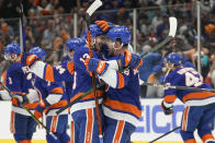 New York Islanders' Mathew Barzal (13) celebrates with Anthony Beauvillier (18) after Beauvillier scored a goal during the overtime period of Game 6 of an NHL hockey semifinals against the Tampa Bay Lightning Wednesday, June 23, 2021, in Uniondale, N.Y. The Islanders won 3-2. (AP Photo/Frank Franklin II)