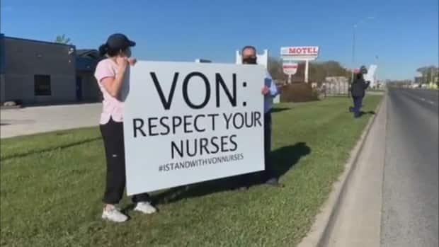 VON nurses in Sarnia, Ont., picket in front of their employers' office on Saturday. (CBC - image credit)