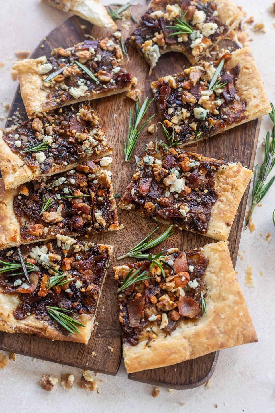 """<p>This recipe calls for homemade puff pastry (a fun holiday baking project you might want to try!), but if you're short on time, you can always use store-bought puff pastry, too. </p><p><strong>Get the recipe at <a href=""""https://britneybreaksbread.com/caramelized-onion-puff-pastry-with-bacon-and-gorgonzola/"""" rel=""""nofollow noopener"""" target=""""_blank"""" data-ylk=""""slk:Britney Breaks Bread"""" class=""""link rapid-noclick-resp"""">Britney Breaks Bread</a>.</strong></p>"""