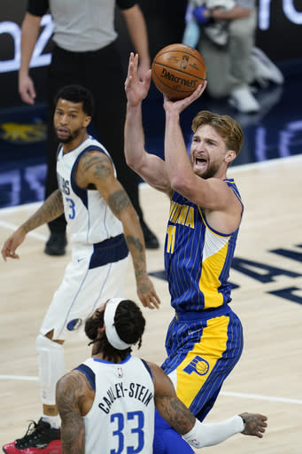Indiana Pacers' Domantas Sabonis (11) shoots over Dallas Mavericks' Willie Cauley-Stein (33) during the first half of an NBA basketball game, Wednesday, Jan. 20, 2021, in Indianapolis. (AP Photo/Darron Cummings)