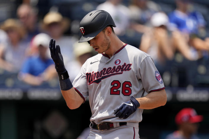 Minnesota Twins' Max Kepler celebrates after hitting a solo home run during the sixth inning of a baseball game against the Kansas City Royals Sunday, July 4, 2021, in Kansas City, Mo. (AP Photo/Charlie Riedel)
