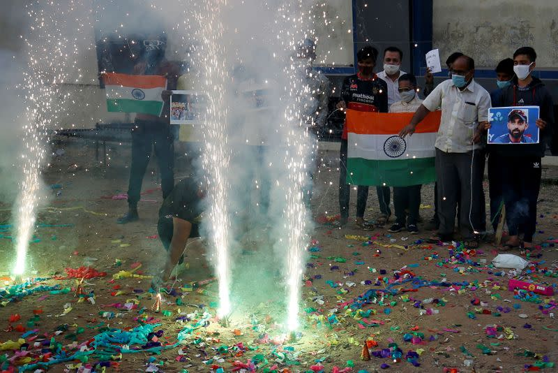 Indian cricket fans celebrate the victory in Ahmedabad