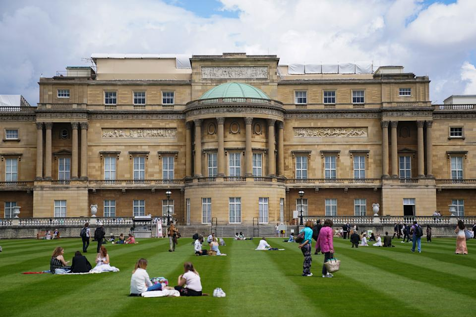 Visitors enjoy picnics on the lawn during a preview of the Garden at Buckingham Palace, Queen Elizabeth II's official residence in London, which opens to members of the public on Friday. Visitors will be able to picnic in the garden and explore the open space for the first time. Picture date: Thursday July 8, 2021. (Photo by Kirsty O'Connor/PA Images via Getty Images)