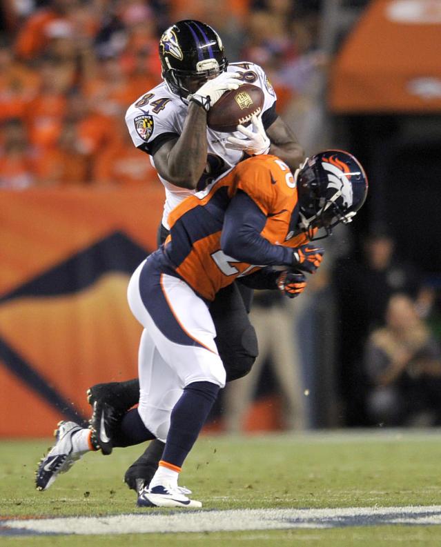 Baltimore Ravens tight end Ed Dickson (84) pulls in a pass as Denver Broncos strong safety Mike Adams (20) defends during the first half of an NFL football game, Thursday, Sept. 5, 2013, in Denver. (AP Photo/Jack Dempsey)