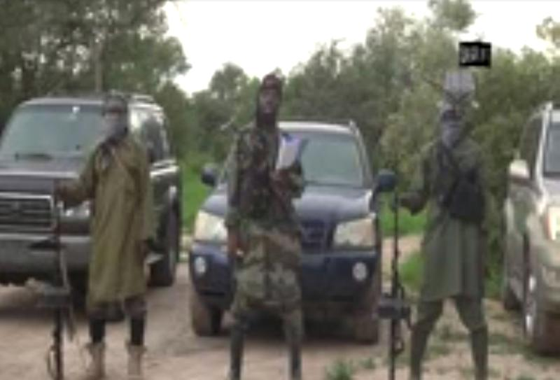 A screengrab taken on August 24, 2014 from a video shows the leader of the Nigerian Islamist extremist group Boko Haram, Abubakar Shekau (C), delivering a speech at an undisclosed location (AFP Photo/)