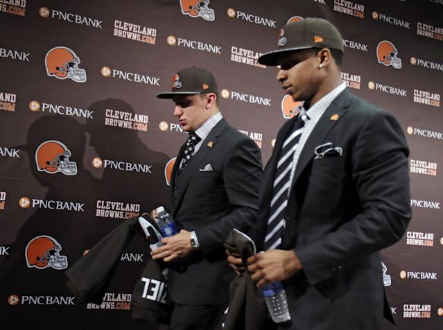 Cleveland Browns quarterback Johnny Manziel, left, and cornerback Justin Gilbert, leave their introductory news conference at the NFL football team's facility in Berea, Ohio Friday, May 9, 2014. Cleveland Browns quarterback Johnny Manziel, from Texas A&M, answers questions at his introductory news conference at the NFL football team's facility in Berea, Ohio Friday, May 9, 2014. The Browns selected Manziel 22nd overall in the first round in Thursday's NFL draft, after taking Oklahoma State cornerback Justin Gilbert with the eighth pick. (AP Photo/Tony Dejak)