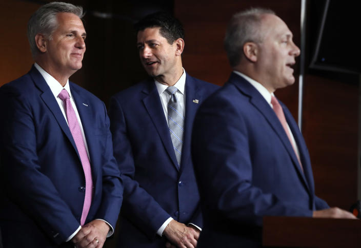 House Speaker Paul Ryan of Wis., center, talks with House Majority Leader Kevin McCarthy of Calif., left, while House Majority Whip Steve Scalise, R-La., speaks during a news conference, Thursday, Sept. 13, 2018, in Washington. (AP Photo/Jacquelyn Martin)
