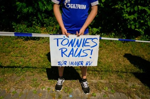 """A Schalke fan holds a placard reading """"Toennies out"""" during Saturday's protests against club chairman Clemens Toennies who has resigned"""