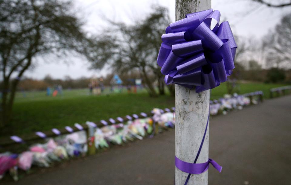 Purple bows and ribbons attached to lamp posts and railings in St Neot's Road, Harold Hill, east London, in memory of 17-year-old Jodie Chesney, who was murdered on Friday night whilst sitting in a park with her friends. A second person has been arrested on suspicion of her murder.