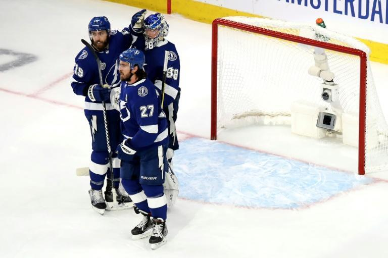 Andrei Vasilevskiy #88, Barclay Goodrow #19 and Ryan McDonagh #27 of the Tampa Bay Lightning celebrate their win against the Dallas Stars in Game Two of the 2020 NHL Stanley Cup Final on September 21, 2020 in Edmonton, Alberta, Canada