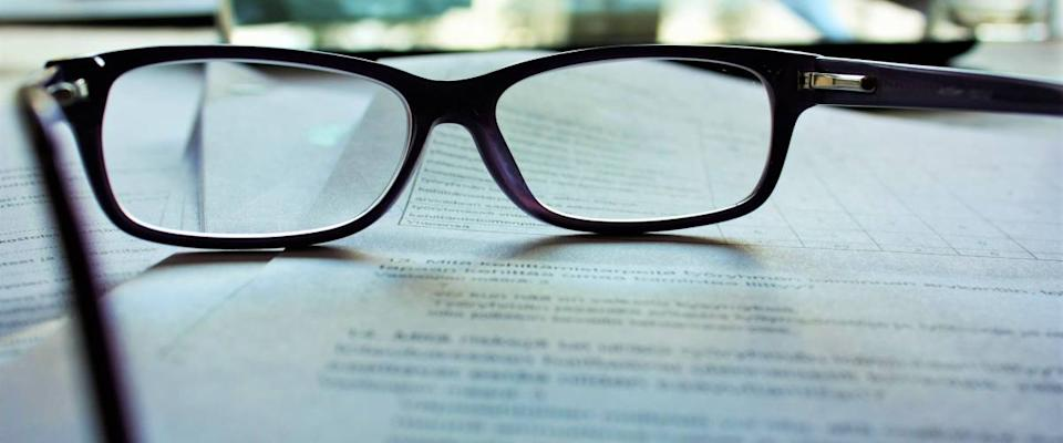 Reading glasses on a legal contract