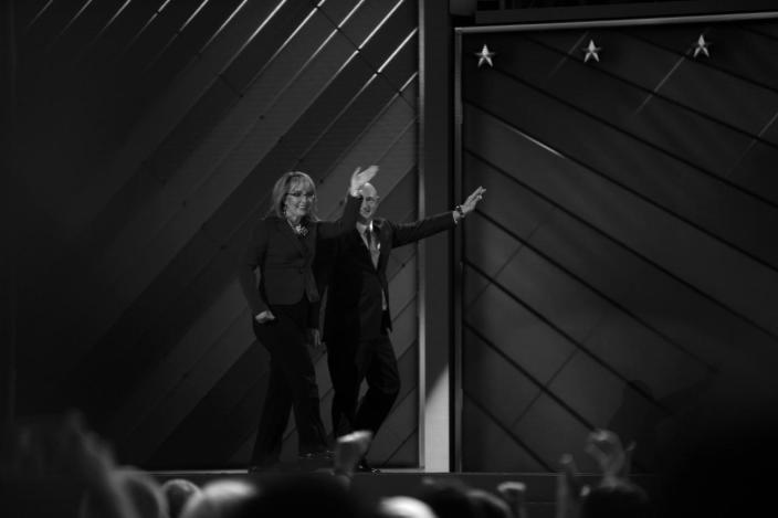 <p>Former Rep. Gabby Giffords, D-Ariz, and her husband Astronaut Mark Kelly (ret.), walk off the stage after speaking at the Democratic National Convention Wednesday, July 27, 2016, in Philadelphia, PA. (Photo: Khue Bui for Yahoo News)</p>