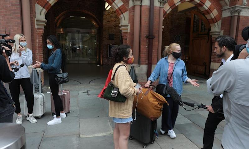 Reporters interview arriving passengers at St Pancras.