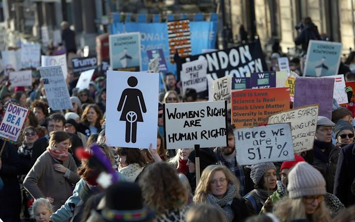 <p>Protesters take part in the Women's March on London, as they walk from the American Embassy to Trafalgar Square, Jan. 21. formed part of a worldwide day of action following the inauguration of Donald Trump as U.S. president. (Reuters/Neil Hall) </p>