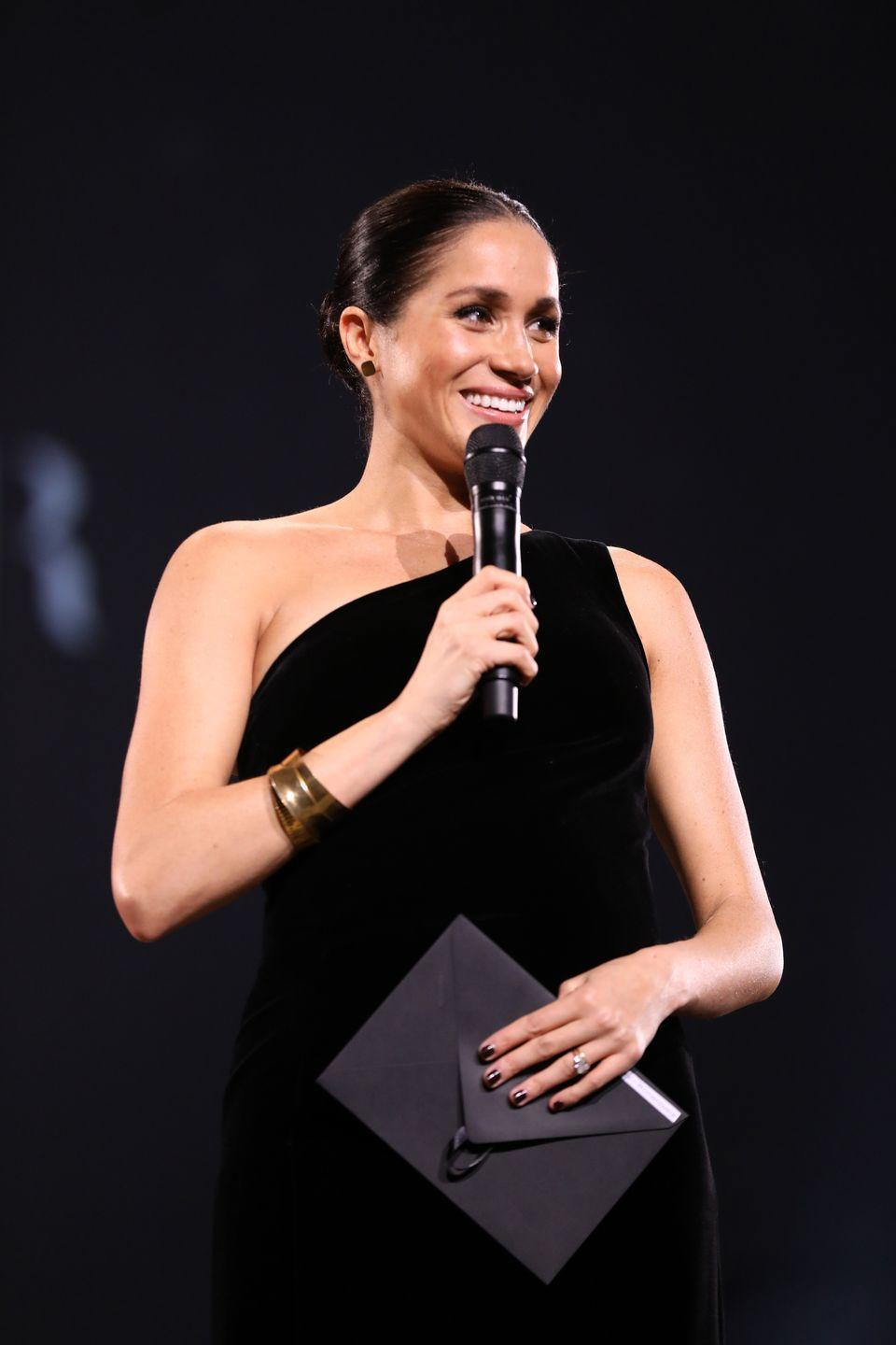 """<p>It's an unspoken rule that royal women should either wear no nail polish or neutral colors (the Queen has been wearing the same light """"Ballet Slippers"""" shade by Essie, or no polish at all, for 28 years!). But Meghan wore dark burgundy polish to The Fashion Awards in December 2018. Scandalous! </p>"""