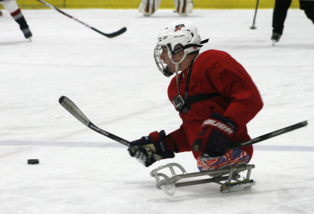 Brody Roybal, 15, practices with his high school hockey team in Franklin Park, Ill., on Tuesday, Feb. 11, 2014. Roybal, a high school sophomore, is the youngest member of the U.S. Paralympic sled hockey team which will play in Sochi, Russia in March 2014. (AP Photo/Martha Irvine)