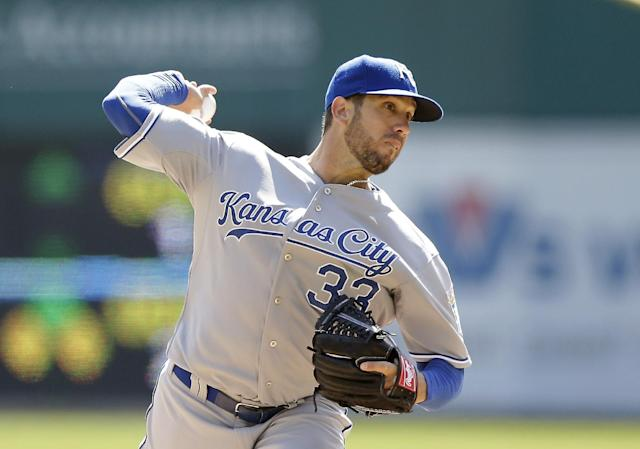 Kansas City Royals starting pitcher James Shields throws during the second inning of a baseball game against the Detroit Tigers in Detroit, Monday, March 31, 2014. (AP Photo/Carlos Osorio)