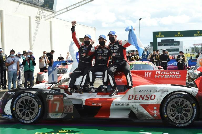 Men of endurance: Toyota drivers Mike Conway, Kamui Kobayashi and Jose Maria Lopez celebrate their Le Mans win