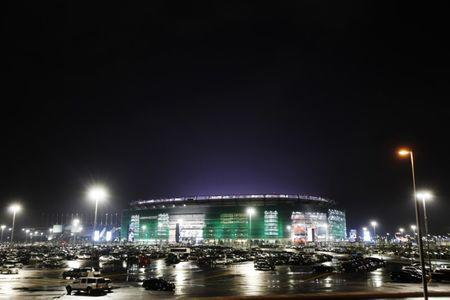The exterior of New Meadowlands Stadium is illuminated during a preseason NFL football game between the New York Jets and the New York Giants in East Rutherford, New Jersey August 16, 2010. REUTERS/Lucas Jackson