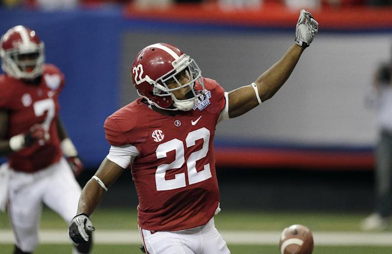 Alabama wide receiver Christion Jones (22) reacts after scoring on a punt return against Virginia Tech in the first half of an NCAA college football game, Saturday, Aug. 31, 2013, in Atlanta. (AP Photo/Dave Martin)