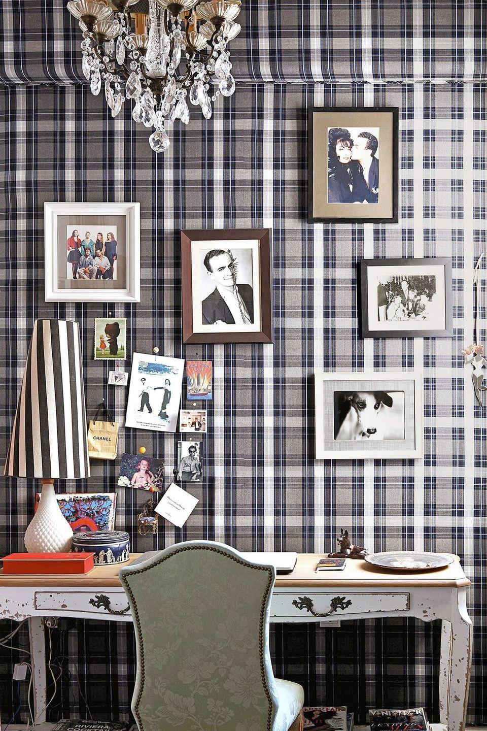 <p>Covering a wall with plaid fabric (or any patterned fabric, for that matter) is a clever way to personalize your space. Plus, if you stick thin cork squares behind select areas of the wall, you can pin photos, prints, and notes straight to it. </p>