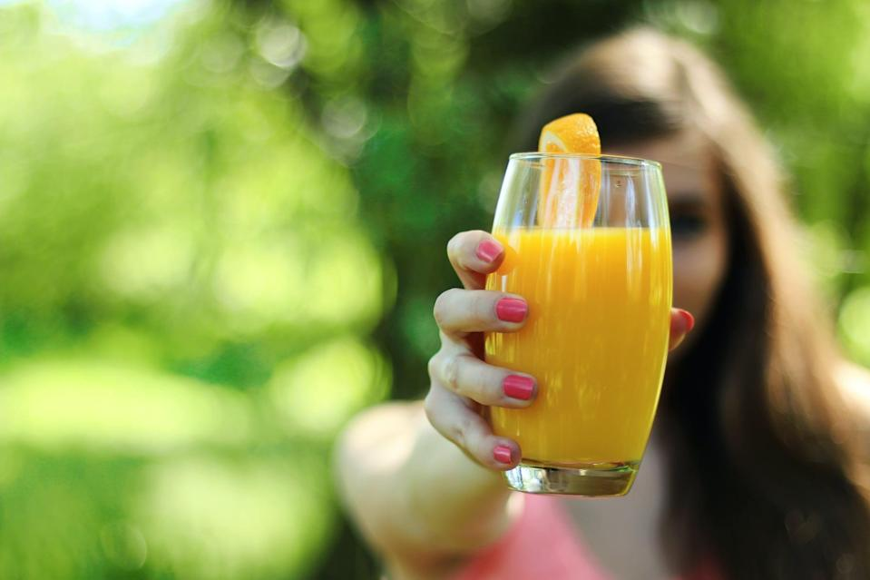 "<p>If you're keeping fortified orange juice on hand, know that one 8-ounce glass gives your body a whopping <a href=""https://fdc.nal.usda.gov/fdc-app.html#/food-details/169098/nutrients"" class=""link rapid-noclick-resp"" rel=""nofollow noopener"" target=""_blank"" data-ylk=""slk:15 percent of the daily value of vitamin D"">15 percent of the daily value of vitamin D</a>, along with 100 percent of your daily vitamin C. What's more, 100 percent orange juice contains a natural plant chemical, or flavonoid, that may offer health benefits to humans. In fact, data suggests that among those who consumed flavonoids, there was a <a href=""https://pubmed.ncbi.nlm.nih.gov/27184276/"" class=""link rapid-noclick-resp"" rel=""nofollow noopener"" target=""_blank"" data-ylk=""slk:33 percent decrease in upper respiratory tract infections"">33 percent decrease in upper respiratory tract infections</a>, compared with those who did not consume flavonoids.</p>"