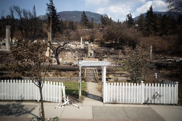 Damaged structures are seen in Lytton, B.C., on Friday, July 9 after a wildfire destroyed most of the village on June 30. A former resident has filed a potential class-action lawsuit against two rail companies, claiming their negligence causedthe fire. (Darryl Dyck/The Canadian Press - image credit)
