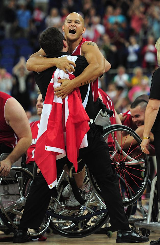 LONDON, ENGLAND - SEPTEMBER 08:  David Eng of Canada celebrates at the end of the gold medal Wheelchair Basketball match between Australia and Canada on day 10 of the London 2012 Paralympic Games at North Greenwich Arena on September 8, 2012 in London, England.  (Photo by Shaun Botterill/Getty Images)