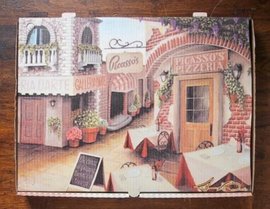 """""""Viva La Pizza! The Art of the Pizza Box"""" by Scott Weiner highlights his collection of more than 550 pizza boxes from around the world. Pictured: Picasso's Pizzeria in Buffalo, N.Y., commissioned local artist Michael Biondo to create this image of an inviting Italian village"""